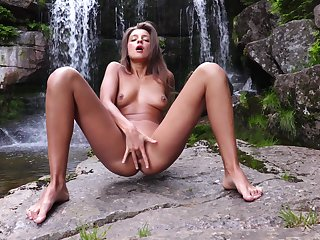 Great nudity and finger fucking over by the water falls