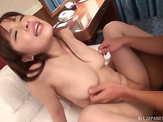 Slender Japanese babe moans while having passionate sex with her BF