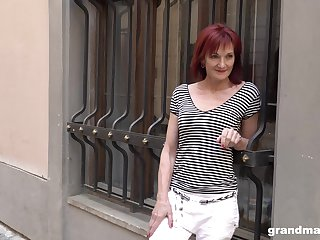 Real granny escort Claudia picks up one young guy on the street