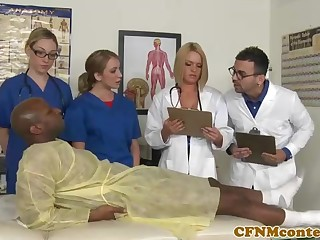 A queer ebony patient is porking a saucy nurse who luvs to gargle rock hard sausages