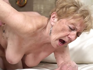A nasty old granny is object fucked in her pussy doggy style