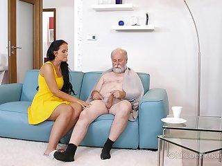 Young busty nurse Jennifer Mendez gives a blowjob and titjob to one old man