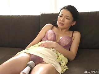 Shy Japanese darling teases with her boobies and wet pussy